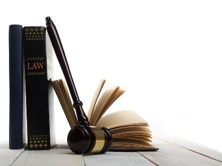 upright law book, an open book and gavel